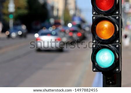 Traffic sign. Green traffic light.