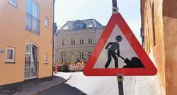 Traffic sign informing of road work ahead and blocked street in Danish street
