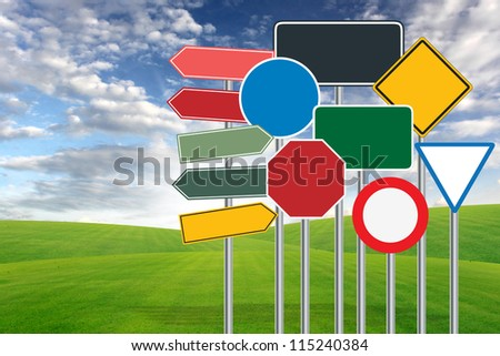 traffic sign on blue sky and green grass background