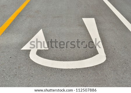 traffic sign on the road.,arrow sign on the way.