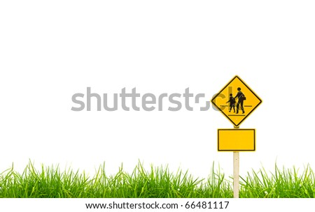 Traffic sign (School warning sign) on grass. - stock photo