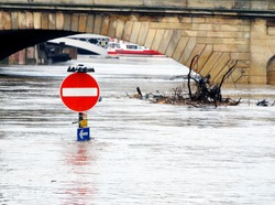 Traffic sign stands underwater during River Ouse floods. York, North Yorkshire, UK.