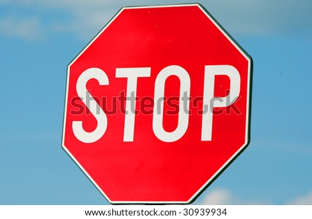 Traffic sign Stop against sky background