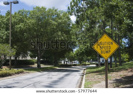 Traffic sign warning of speed bump ahead