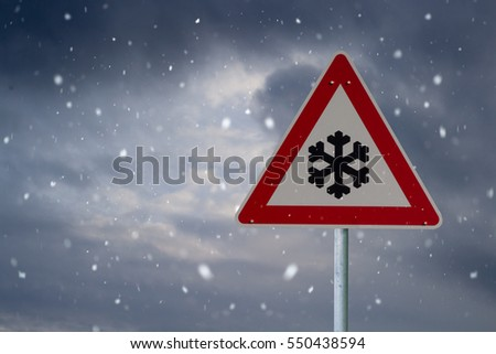 traffic sign winter with dark clouds #550438594