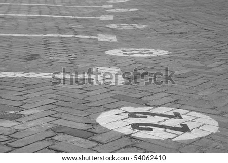 Traffic signals painted over the ground of a parking. - stock photo