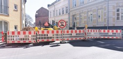 Traffic signs and road blockage due to roadwork and maintenance of the street in a Danish city