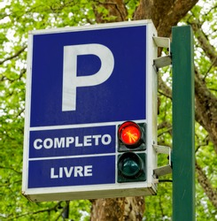 Traffic signs for parking and paid parking zones with traffic light in Furnas