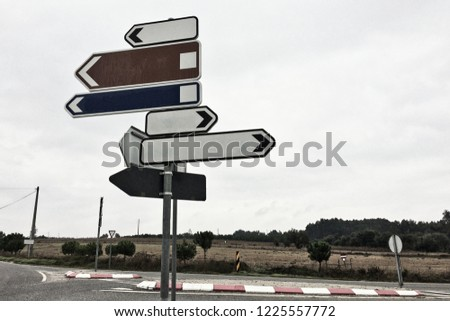 traffic signs showing in different directions #1225557772