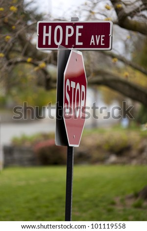 Traffic signs with Hope Avenue and Stop written on them.