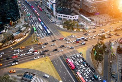 Traffic speeds through an intersection in Gangnam.Gangnam is an affluent district of Seoul. South Korea.