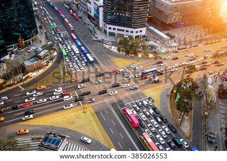 Traffic speeds through an intersection in Gangnam.Gangnam is an affluent district of Seoul. South Korea.