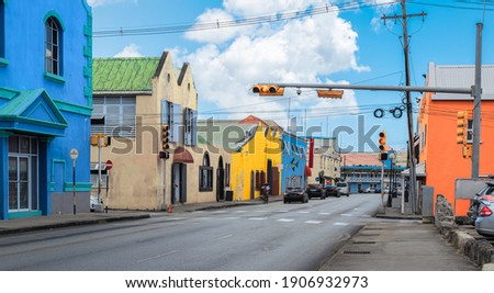 Traffic street and colorful buildings in city centre of Bridgetown, Barbados. Foto stock ©
