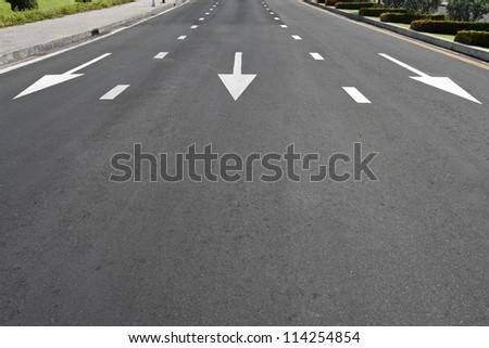 Traffic symbol on surface road - stock photo