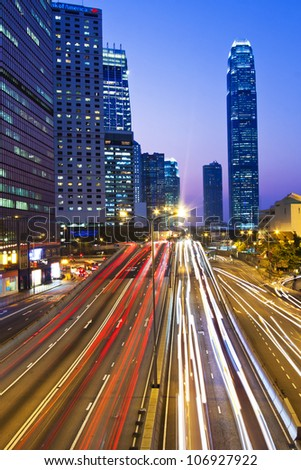 Traffic though downtown in Hong Kong - stock photo