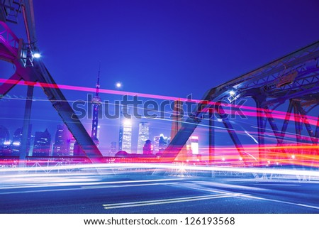 traffic through bridge with blur trail
