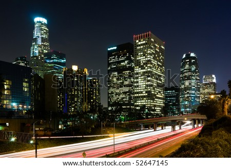 Traffic through Los Angeles at night - stock photo