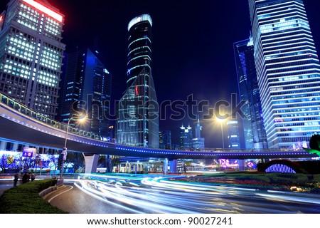 traffic through modern city at night in shanghai