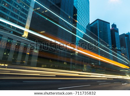 traffic trails in downtown hong kong,china,asia. #711735832