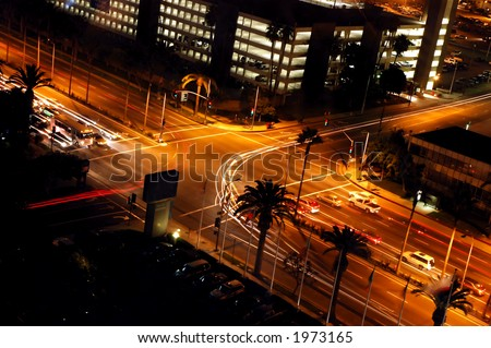 Traffic turning at a light signal at night