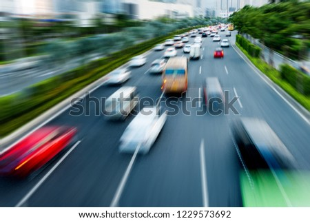 Traffic with motion blur on the street road. #1229573692