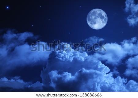 Tragic night sky with a full moon and shining stars