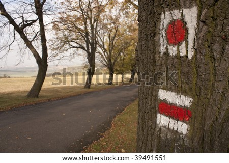 Trail and red sign - touristic path
