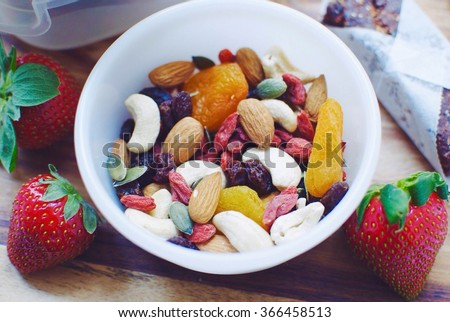 Trail mix and strawberries, healthy snacks  Photo stock ©