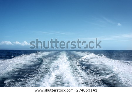 Trail on water surface behind of fast moving motor boat #294053141