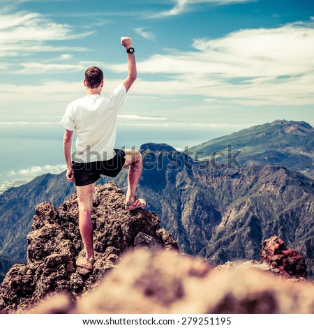 Trail runner, man and success in mountains. Motivation and inspiration on mountains peak. Running, sports, fitness and healthy lifestyle outdoors in summer nature