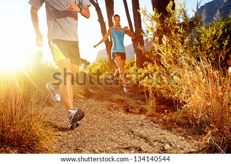 Trail running marathon athlete outdoors sunrise couple training for fitness and healthy lifestyle #134140544