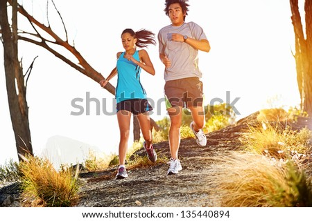 Trail running marathon athlete outdoors sunrise couple training for fitness and healthy lifestyle #135440894