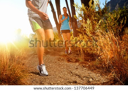 Trail running marathon athlete outdoors sunrise couple training for fitness and healthy lifestyle #137706449