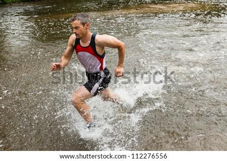 trailrunner with splashing water #112276556