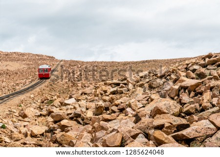 Train and cog track on Pikes Peak railway in Pike National Forest, Colorado #1285624048