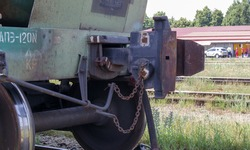 Train carriage on rails. Outdated technology for joining freight train wagons. Oil cargo hitch body for docking. A rail car coupling that connects it to other carriages on the train