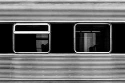 Train carriage windows. Metallic texture monochrome photography.