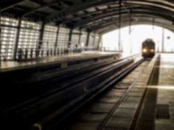 Train come the track at station in Blur style