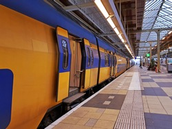 Train departing from Amstel station in Amsterdam Netherlands