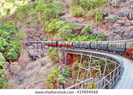 Train going over a bridge over a gorge on the Kuranda Scenic Railway in Barron Gorge National Park, Australia