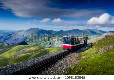 Train going up to the summit of mount Snowdon in Wales UK