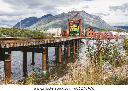 Train heading to White Pass, Skagway Alaska is awaiting its departure on the bridge in Carcross, Yukon Territory, Canada. Close to Bennett lake. Community, little town. Chilkoot trail. Klondike.