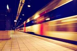 Train in motion blur in subway station.