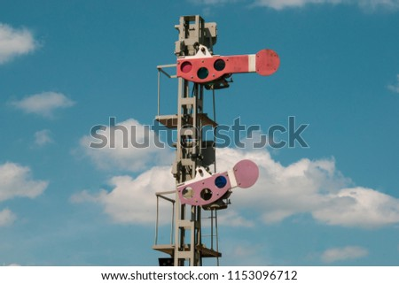 Train indicator on a blue cloudy background
