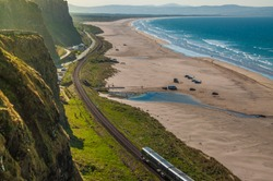 Train journey between Londonderry and Coleraine near the Atlantic Ocean, one of the most beautiful rail journeys in the world.