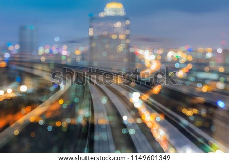 Train motion curved over night blur bokeh light city downtown, abstract background #1149601349