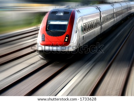 Train moving fast on its tracks.