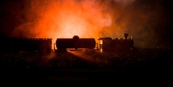 Train moving in fog. Ancient steam locomotive in night. Night train moving on railroad. orange fire background. Horror mystical scene
