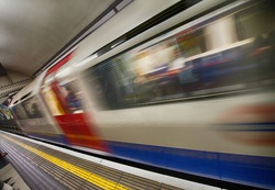 Train moving in speed at Canary Wharf platform