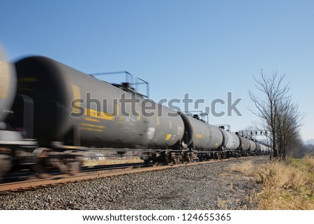 Train of oil tank cars on railroad